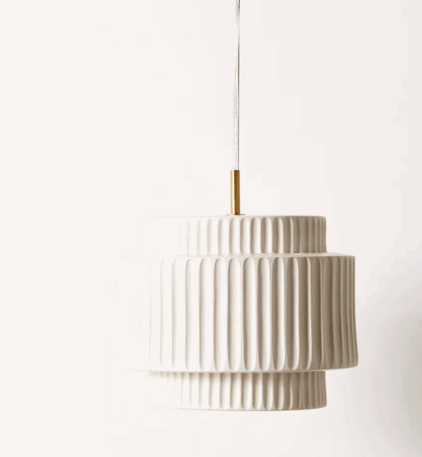 Textured ceramic pendant light fixture from urban outfitters will being a gorgeous glow into your home.