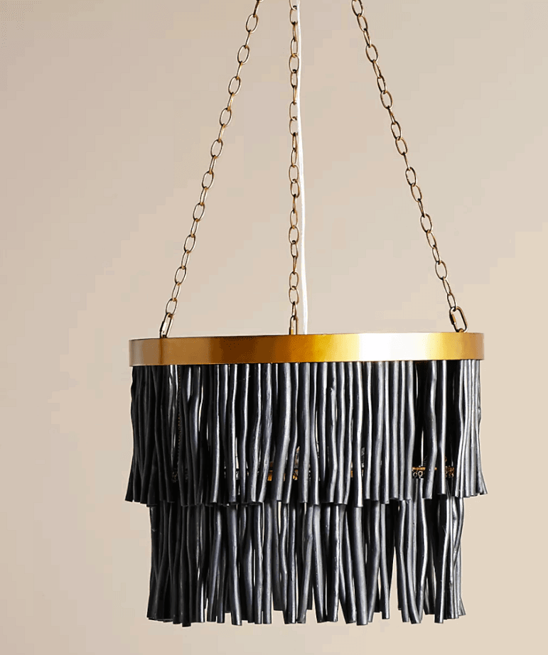 A dramatic boho lighting statement with this black chandelier from Anthropologie.