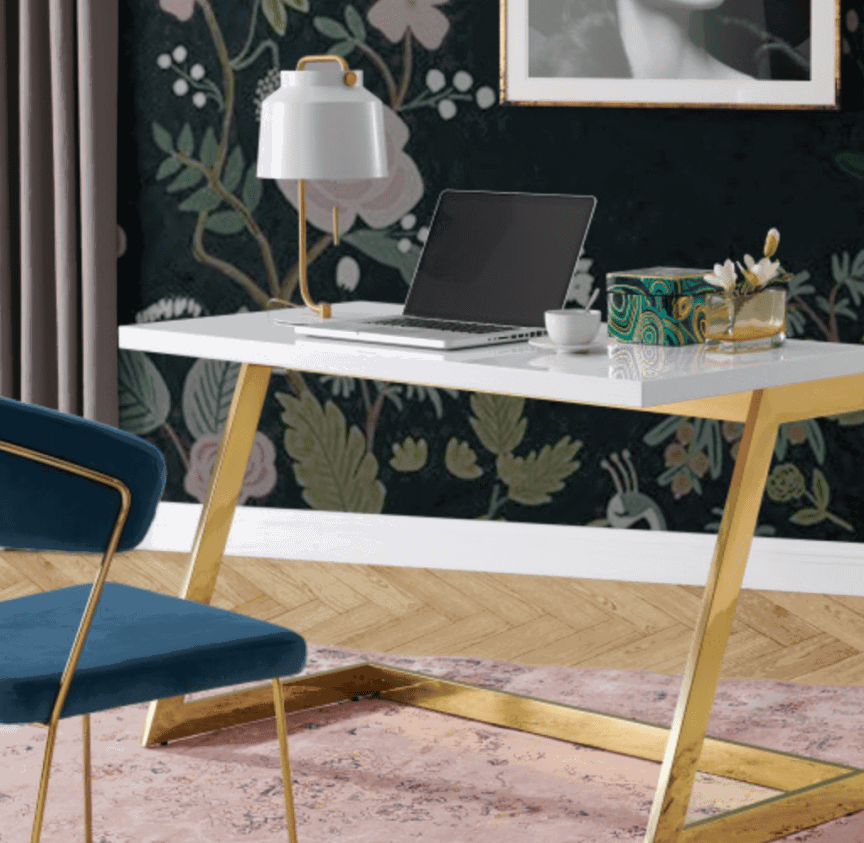 Honour the girl boss in you with this chic home office desk featuring a white lacquer top and brass legs.