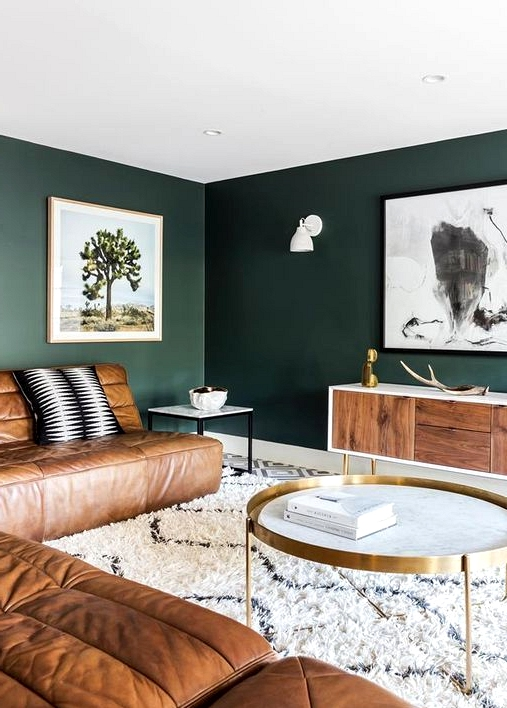Inspiring rooms that feature dark green accent walls.