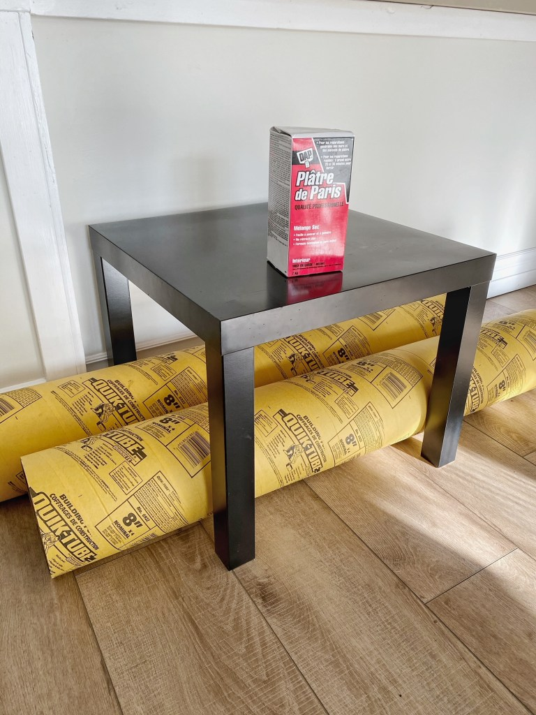 Transform an IKEA LACK side table into a sculptural side table using plaster and concrete tubing.