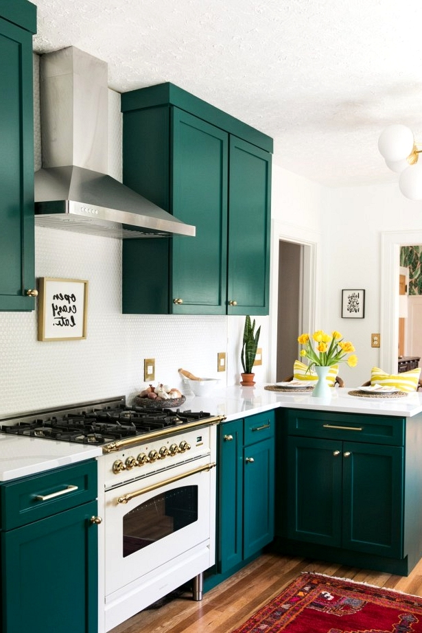 Bright and cheerful green cabinet color scheme in an eclectic kitchen