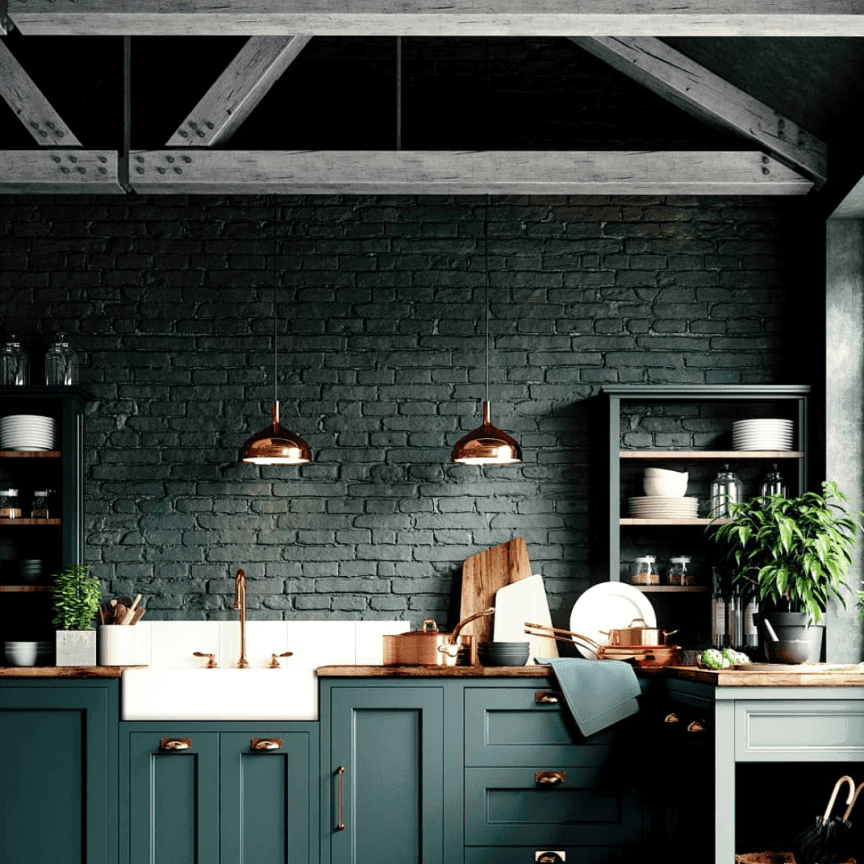 Dark green kitchen with a rustic brick wall.