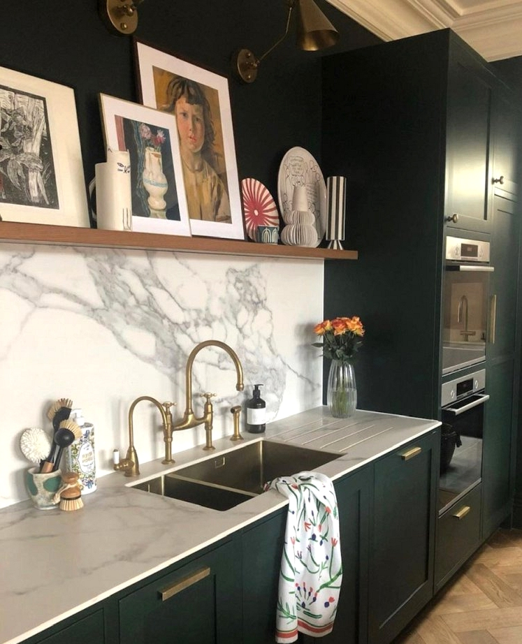 Brass, dark green, and white marble is a trendy color scheme to consider for your home renovation!