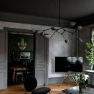 Dramatic dark interiors of magnificent Scandinavian apartment
