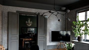 Dramatic darkish interiors of magnificent Scandinavian condominium
