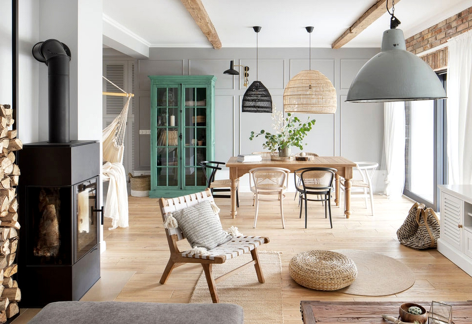 Abundance of wooden and heat mixture of types in design of cozy house in Poznan