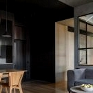 Designer's apartment with small workshop and dark minimal interiors in Moscow (70 sqm)