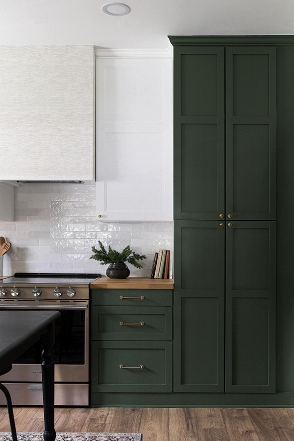 IKEA cabinets get a facelift with dark green paint in this kitchen renovation.