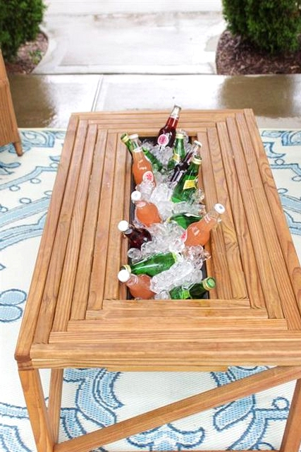 This coffee table with a built in cooler is perfect for your budget friendly backyard space.