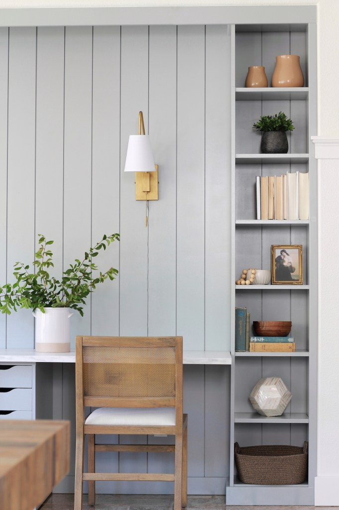 Custom looking built-in bookcase IKEA hack creates a beautiful work from home station.