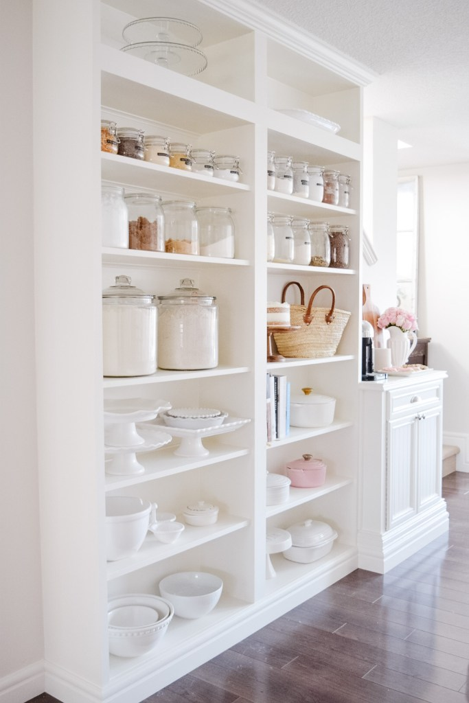 IKEA bookcase turned custom built-in open shelf pantry in this gorgeous kitchen.