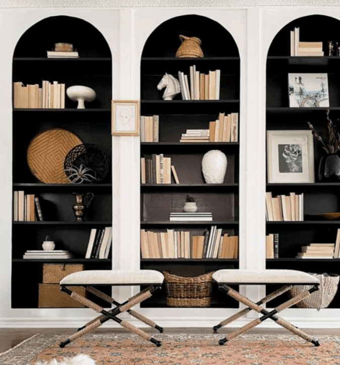 Built-in IKEA BILLY bookcases add seamless storage to this home with a beautiful arch design.