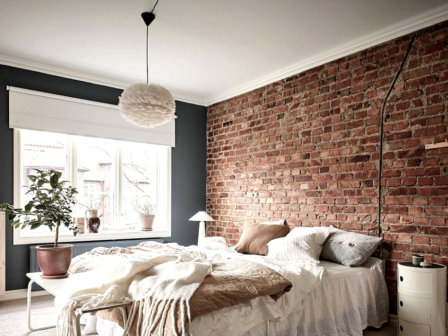 Brick wall and delicate interiors: condominium in 1915 constructing in Goteborg (66 sqm)