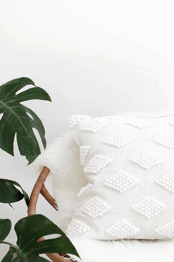 DIY pom pom pillow using fabric glue and ready made pom poms!