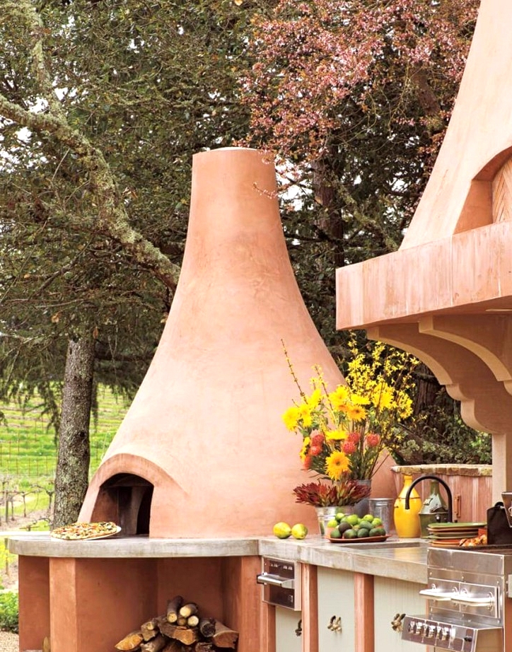Outdoor kitchen design with a huge clay pizza oven